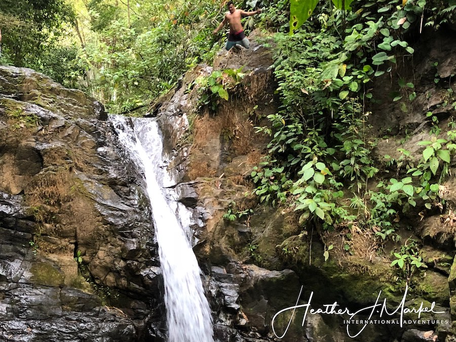 A man jumping off of a waterfall in Uvita.