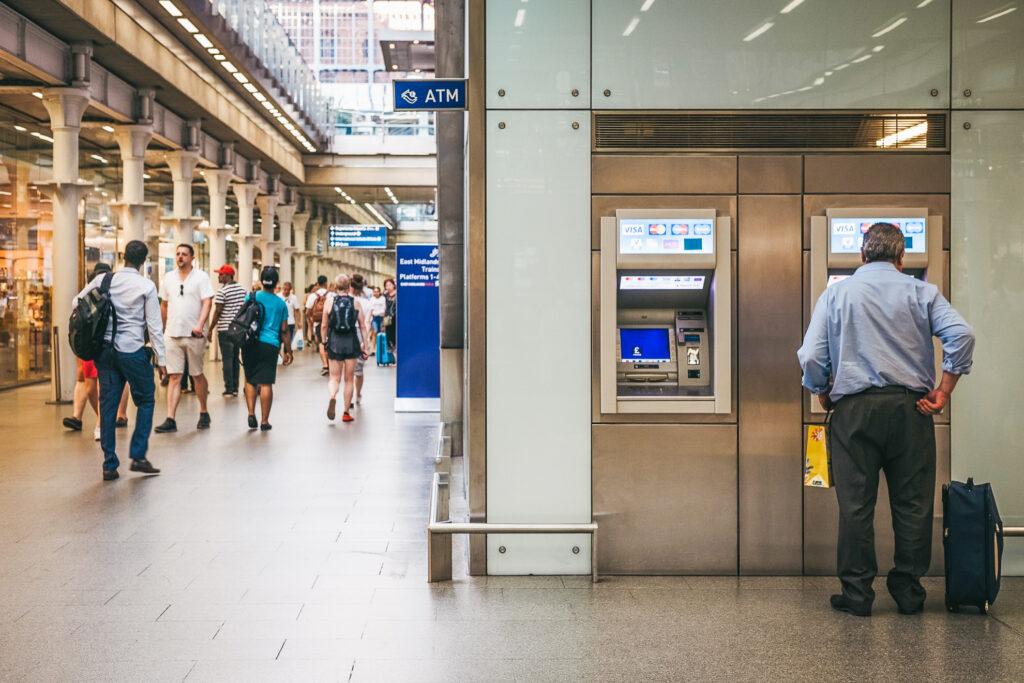 A man using an ATM.