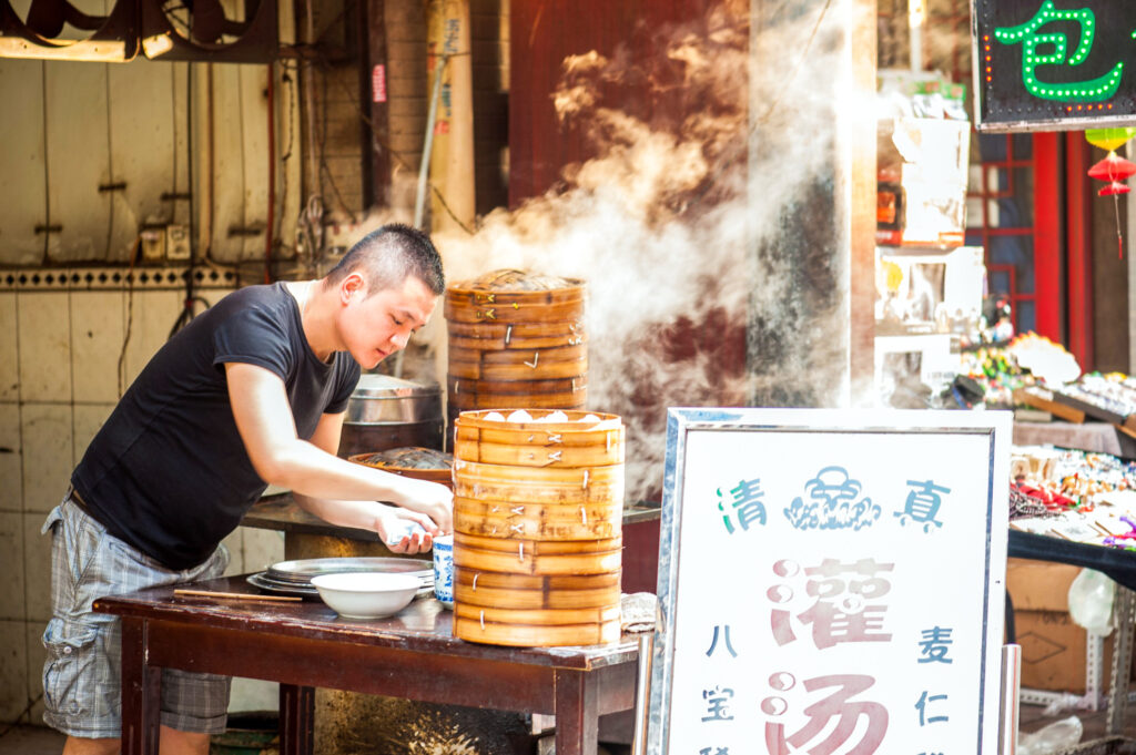 A man working at a food stall in Xi'an.