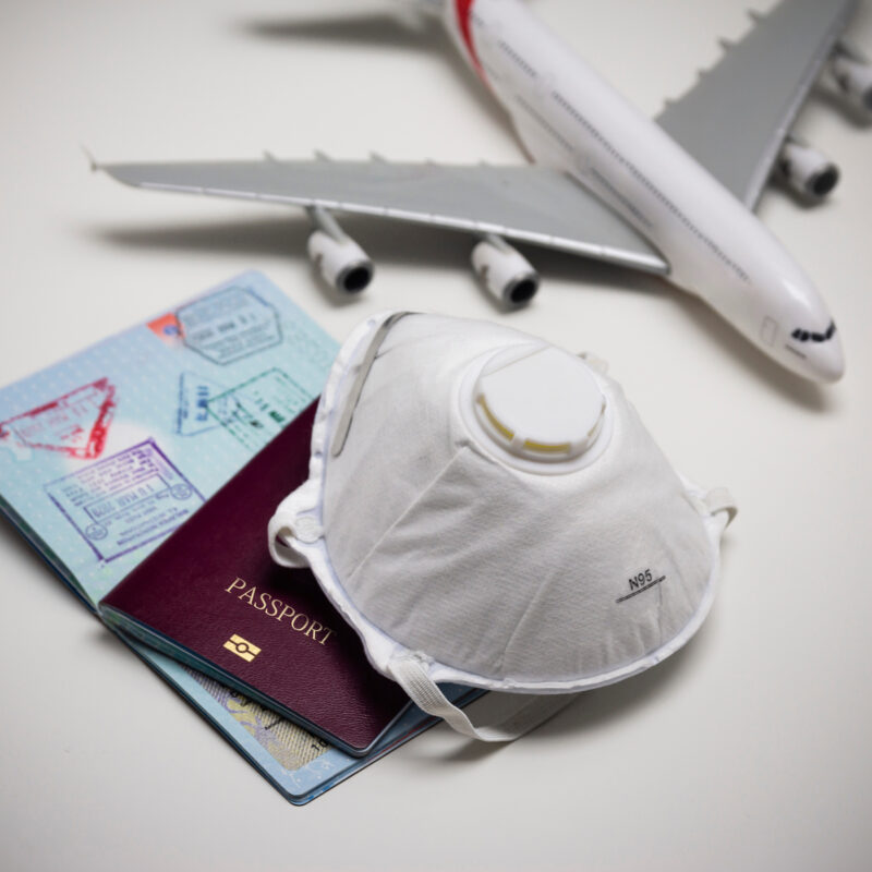 A mask and passport.
