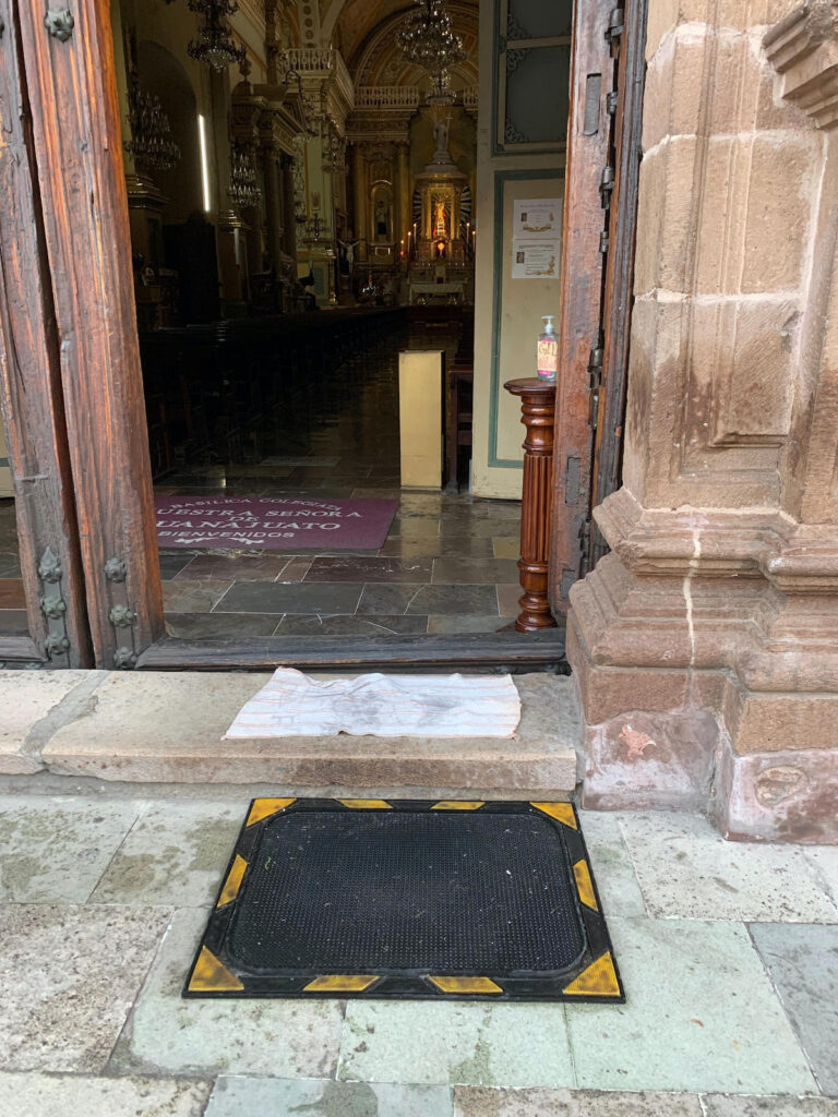 A mat for rinsing shoes outside of a church in Guanajuato.
