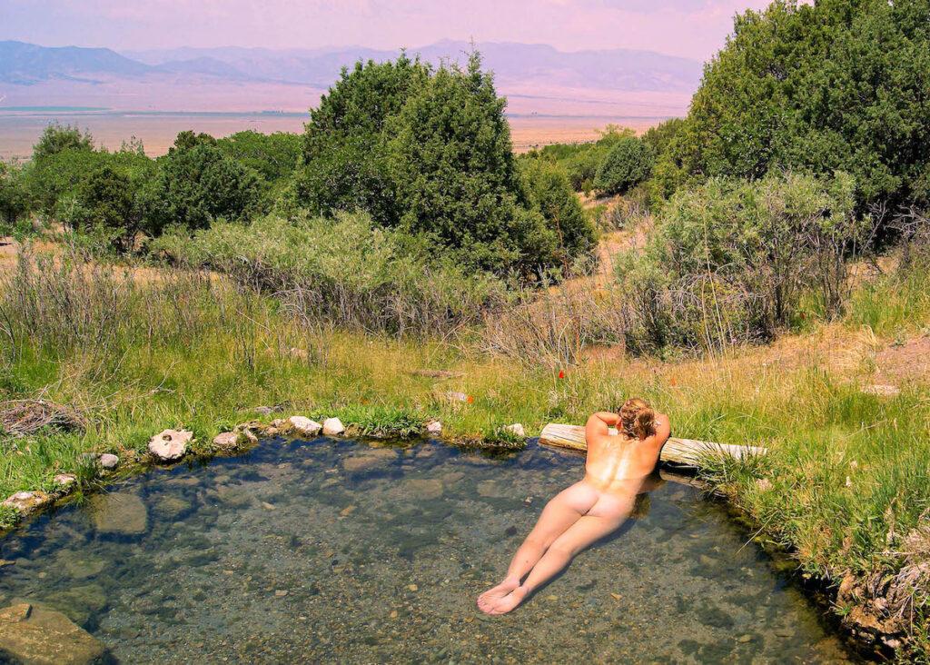 A naturist enjoying a swim.