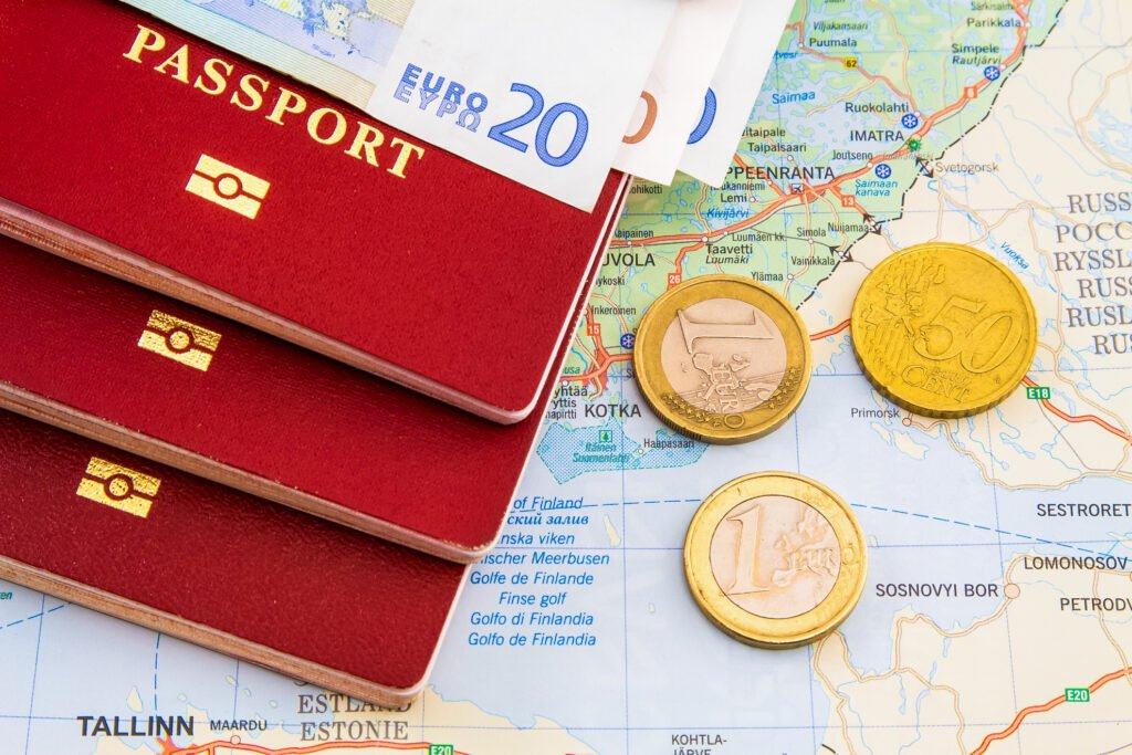 A passport and some euros on a map of Europe.