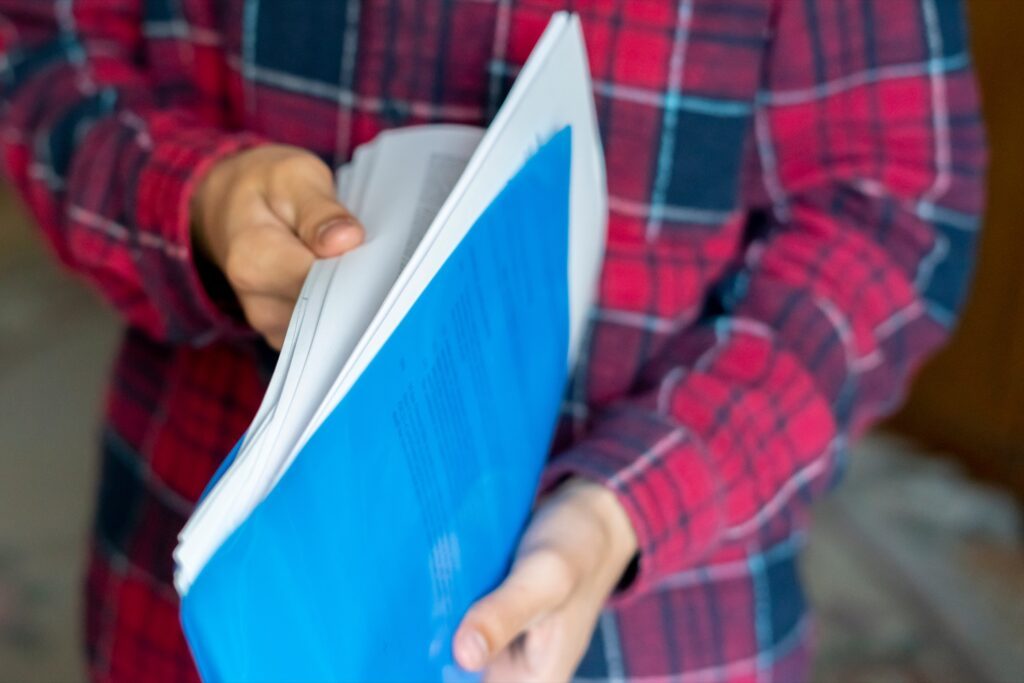 A person holding important documents.