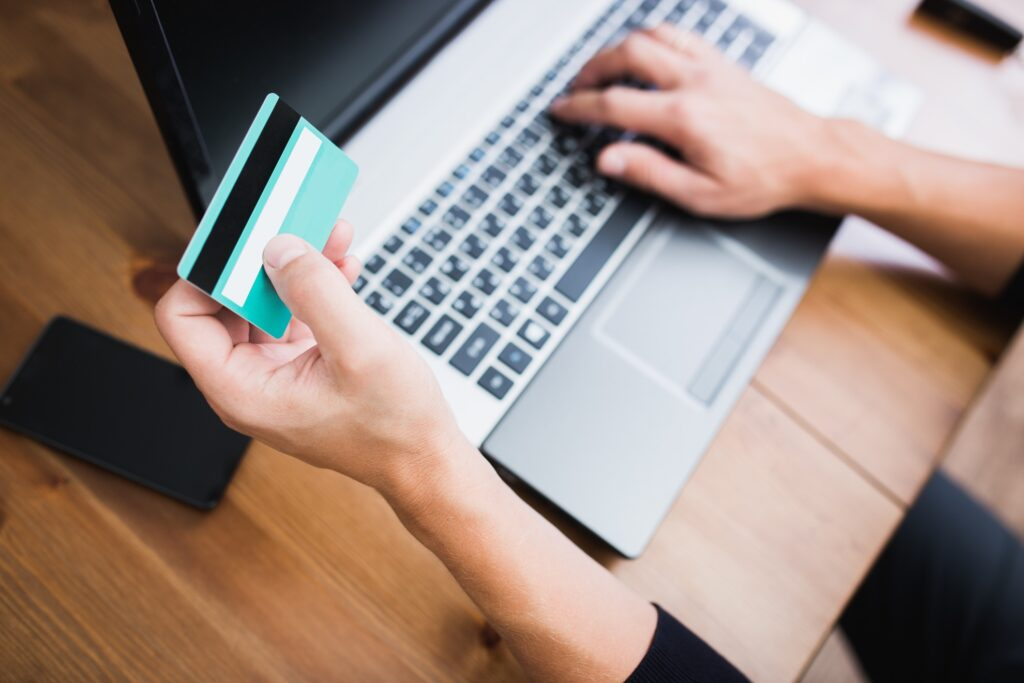 A person looking at their credit card information online.