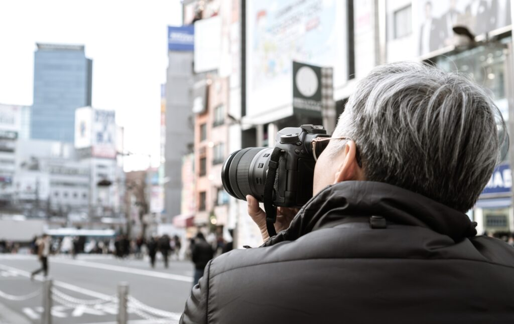 A person taking photographs on a trip.