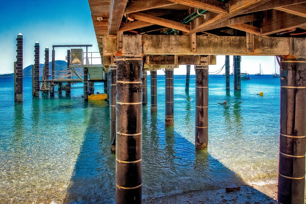 A pier over blue water on Fitzroy Island in the Great Barrier Reef