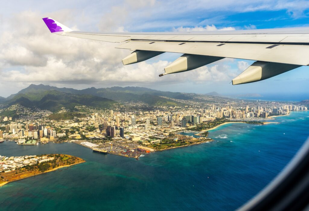 A plane flying over Hawaii.