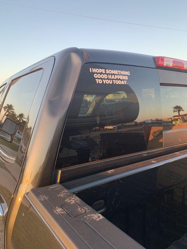 A positive bumper sticker on the writer's truck.
