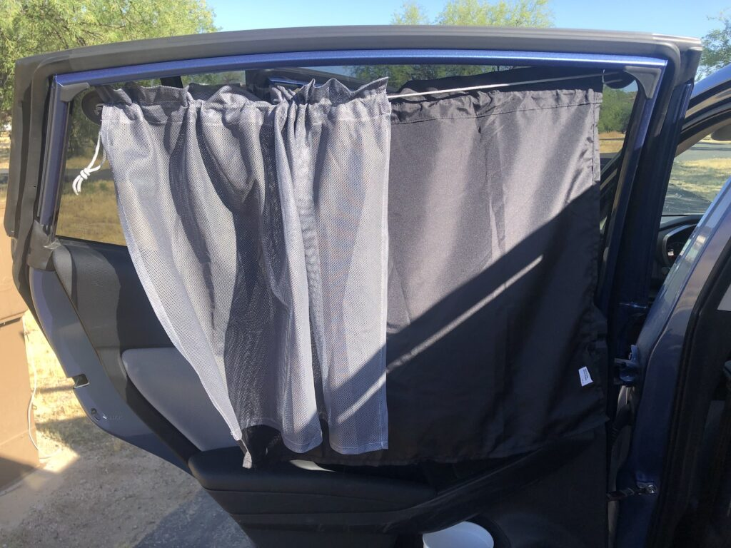 A privacy curtain on the writer's car.