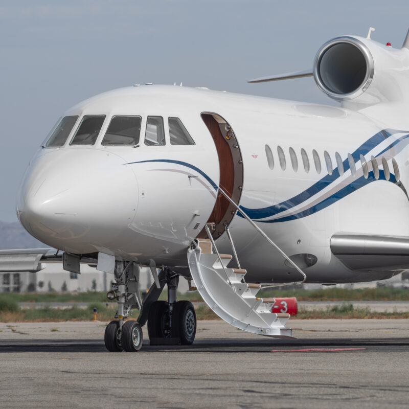 A private jet at an airport.