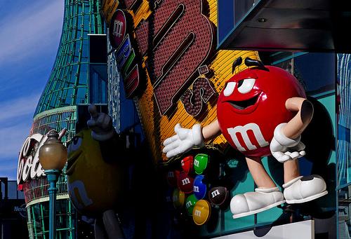 A red M&M candy on the wall of the Vegas M&M shop