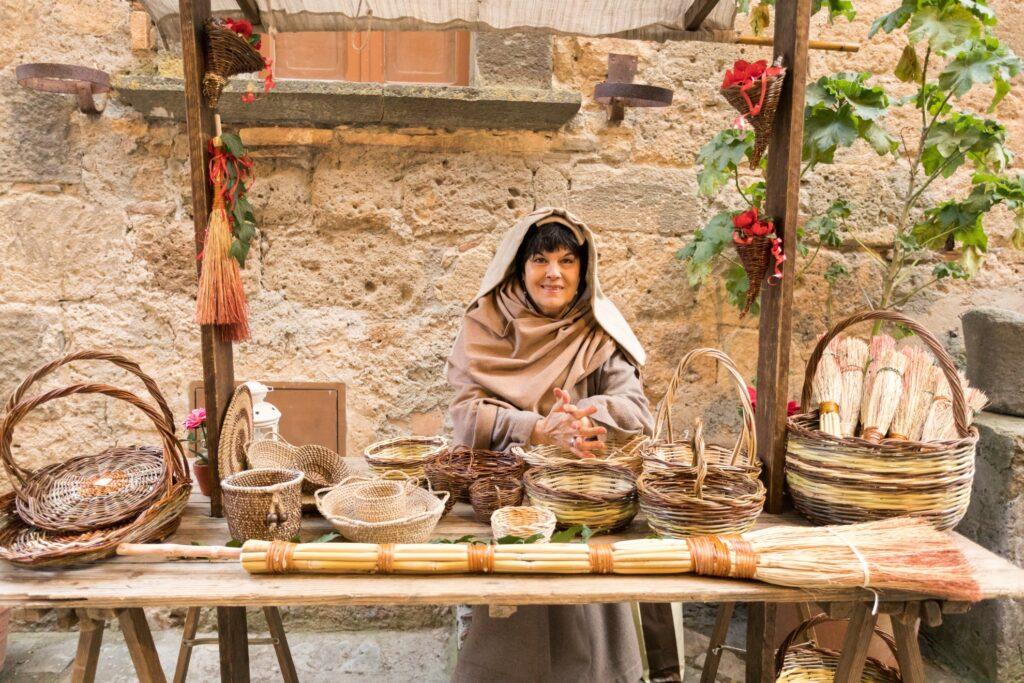 A resident of Civita di Bagnoregio selling woven baskets.