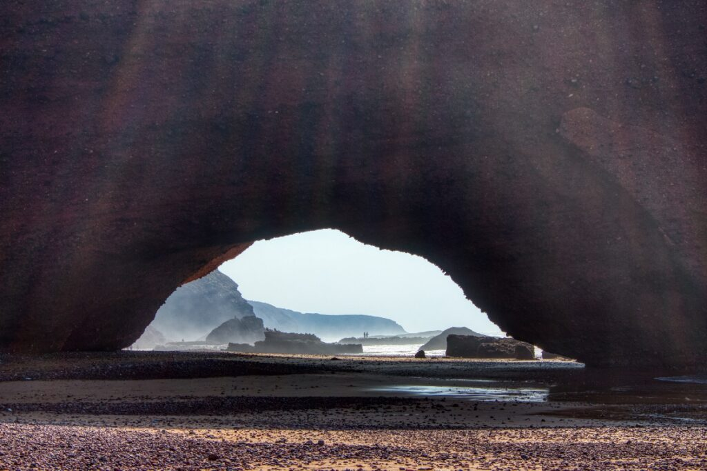 A rock archway at Legzira Beach in Morocco.