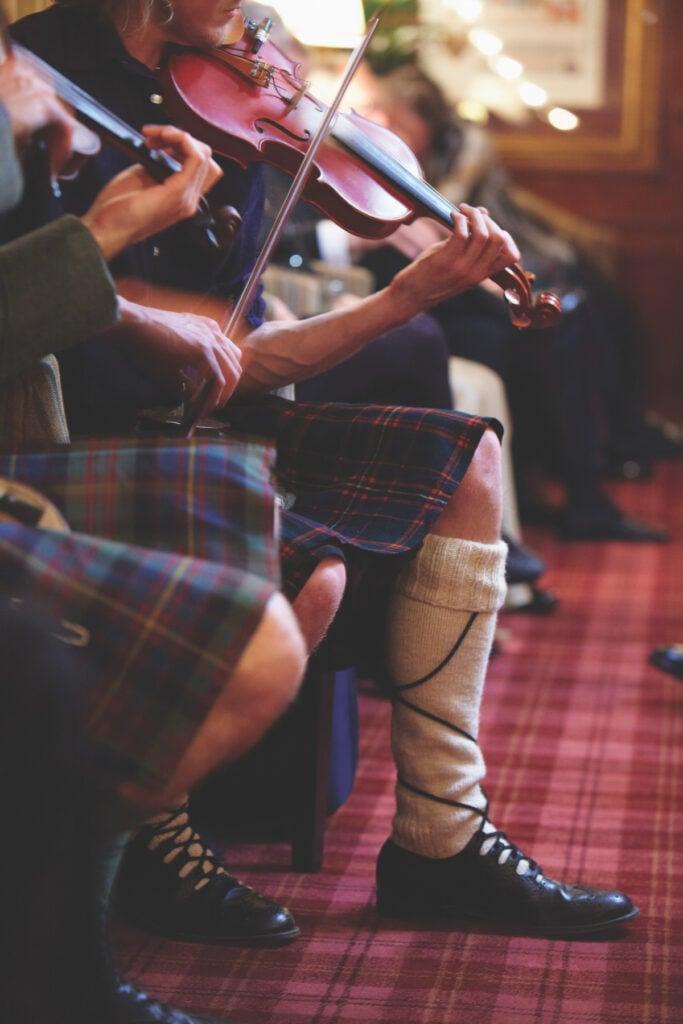 A Scottish band on the Belmond Royal Scotsman train.