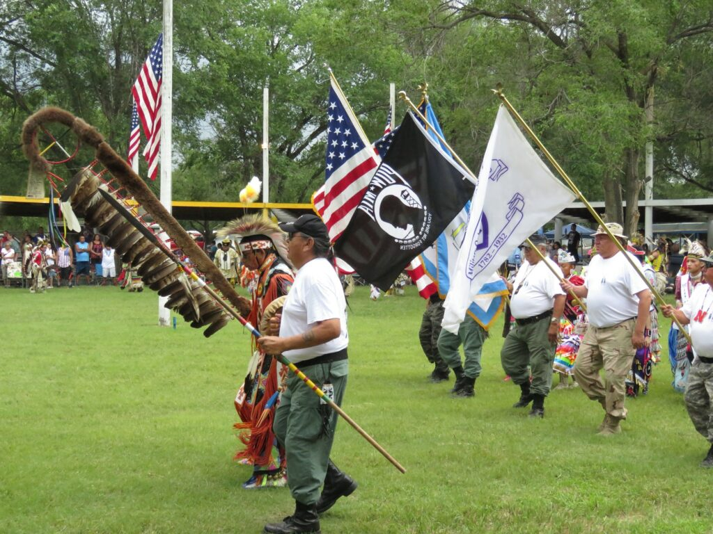 A short ceremony at a powwow honoring veterans.