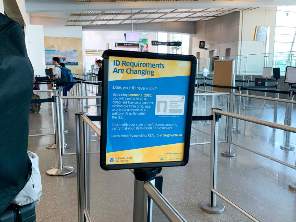 A sign about Real ID requirements in an airport.