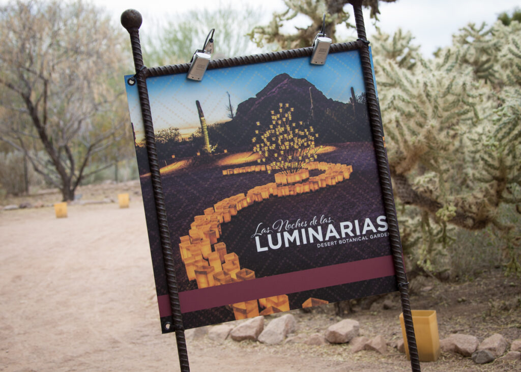 A sign for Las Noches de las Luminarias at the Desert Botanical Garden.