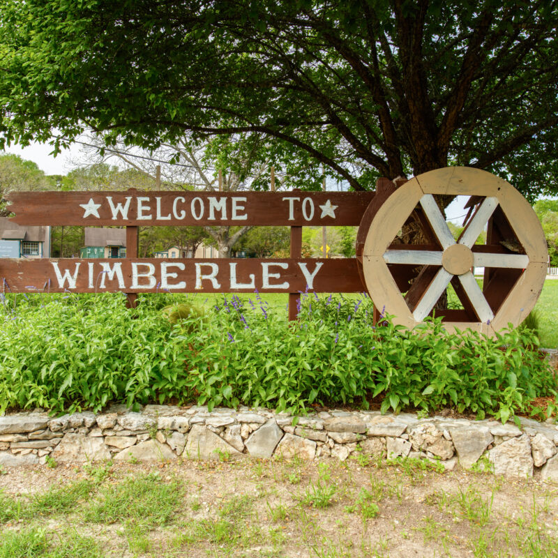 A sign welcoming visitors to Wimberley, Texas.