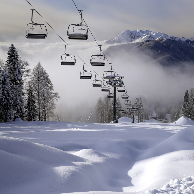 A ski lift on the slopes of a resort.