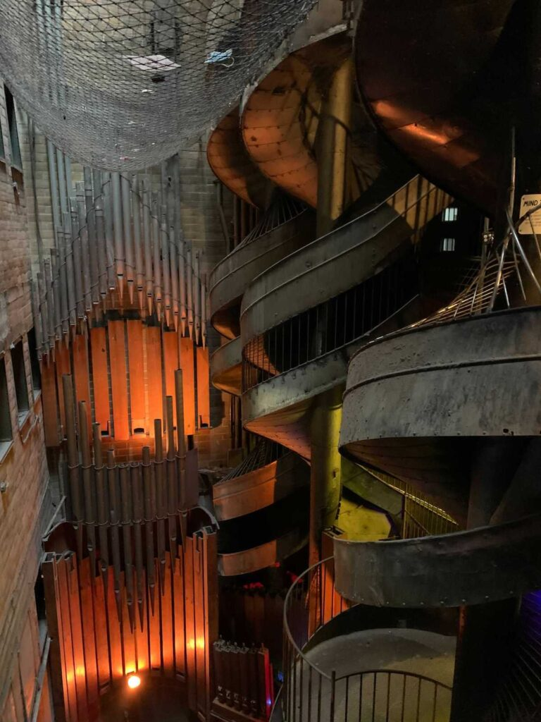 A slide made of metal in the City Museum.