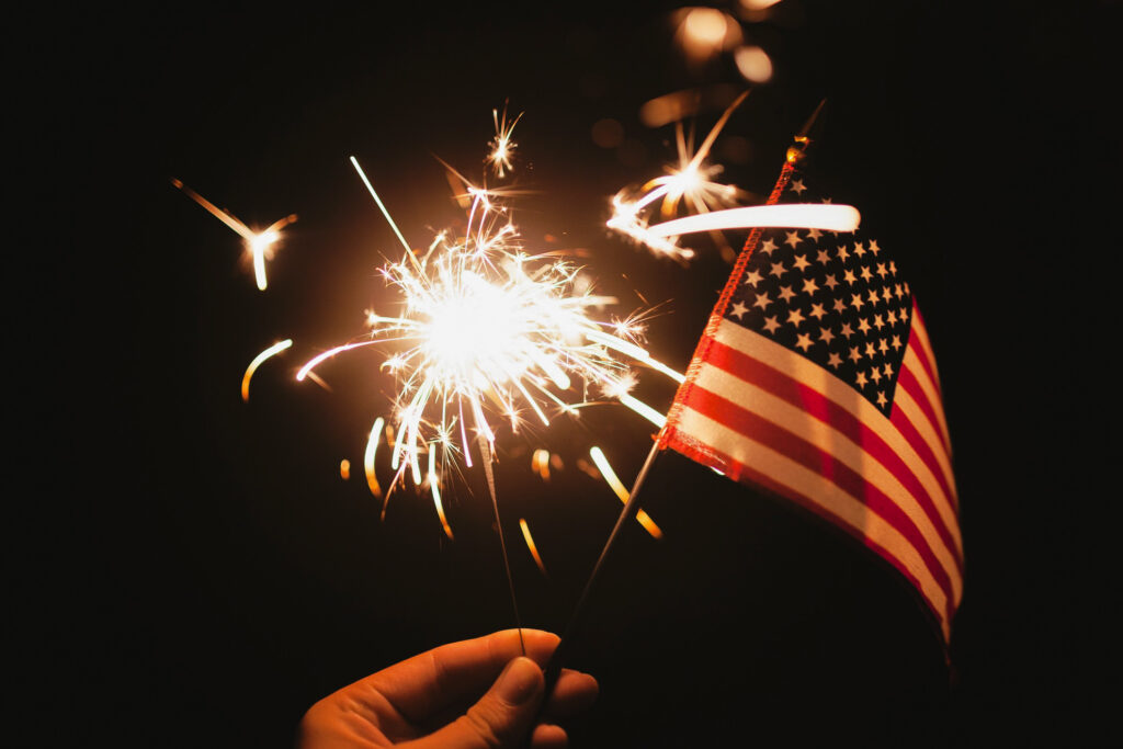 A sparkler and the American flag.