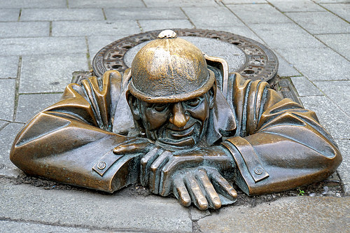 A statue of a man crawling out of sewer hole in Bratislava