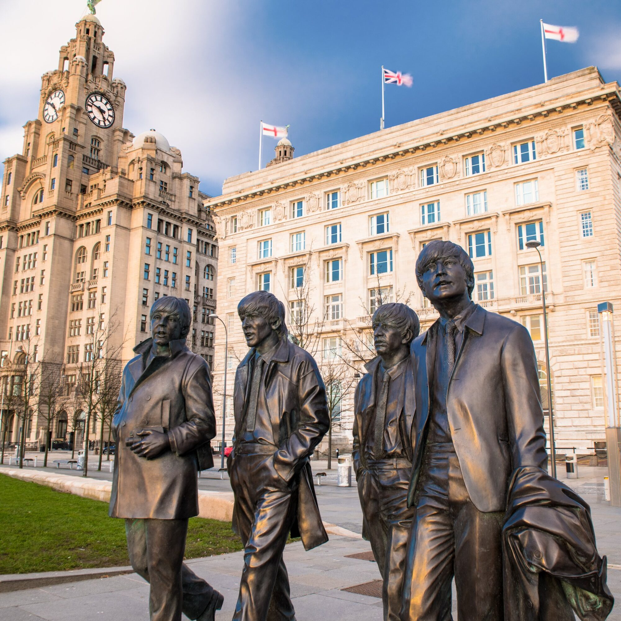 A statue of The Beatles on the on Liverpool Waterfront.