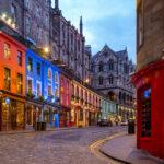 A street full of restaurants and shops in Edinburgh.