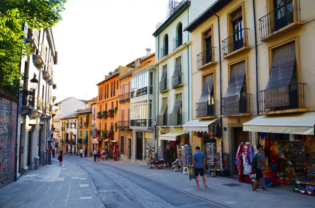 A street lined with shops in Grenada, Spain.