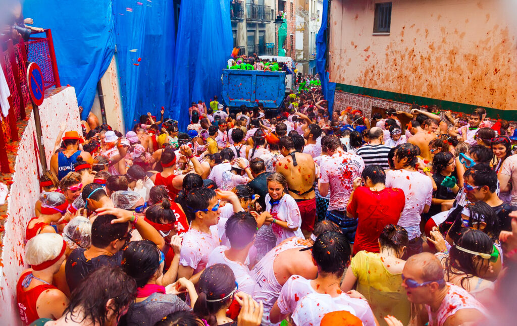 A street of people during the La Tomatina Festival.