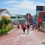 A street of shops and tourists in Freeport, Maine.