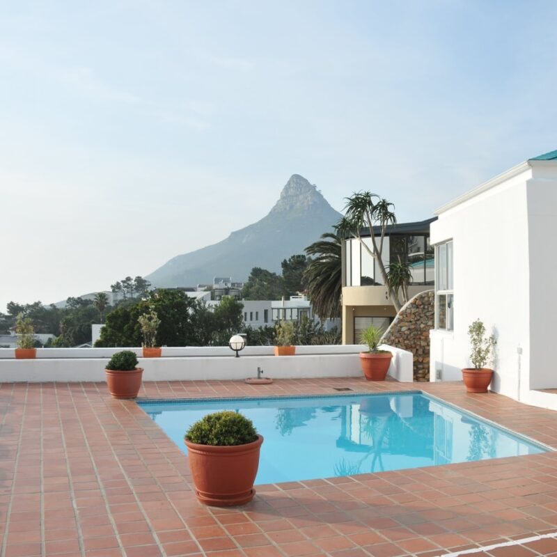 A terrace pool with Lion's Head, Cape Town, South Africa in the distance