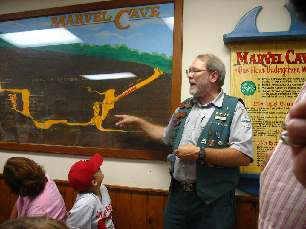 A tour guide at Marvel Cave map in Branson.