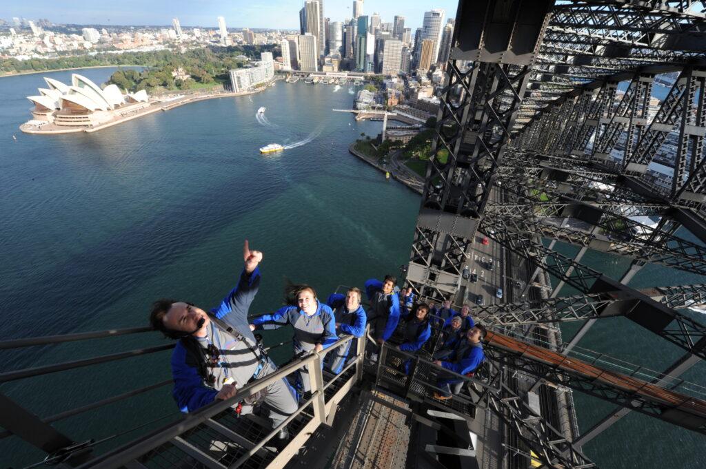 A tour guide leading climbers up the Sydney Harbour Bridge