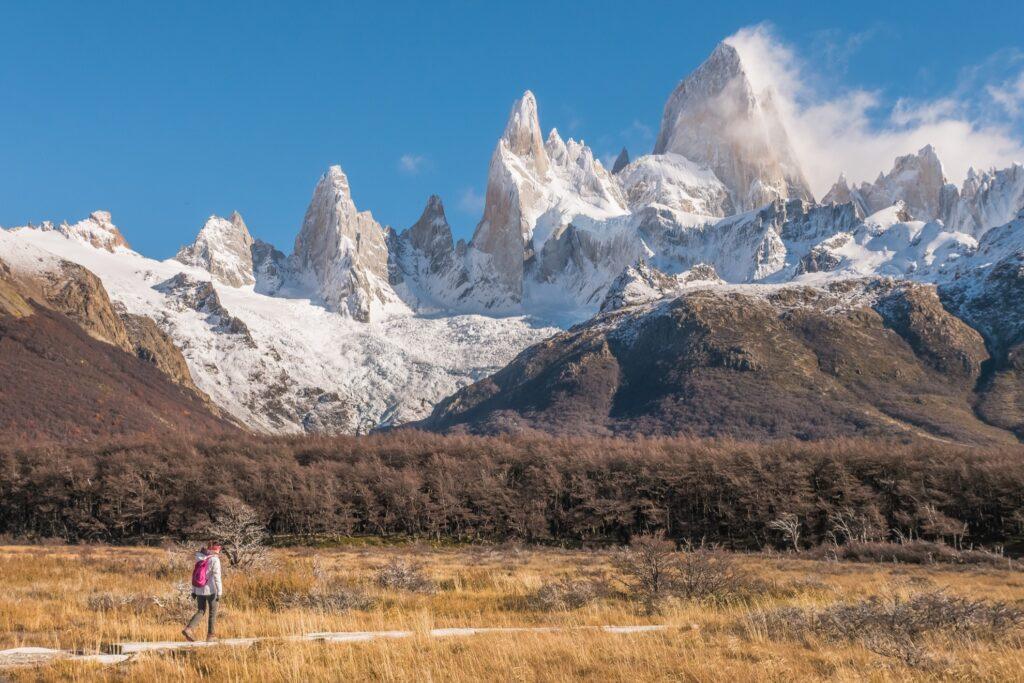 A tourist hiking on a trail in El Chalten.
