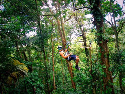 A tourist on a zip line in Saint Lucia.