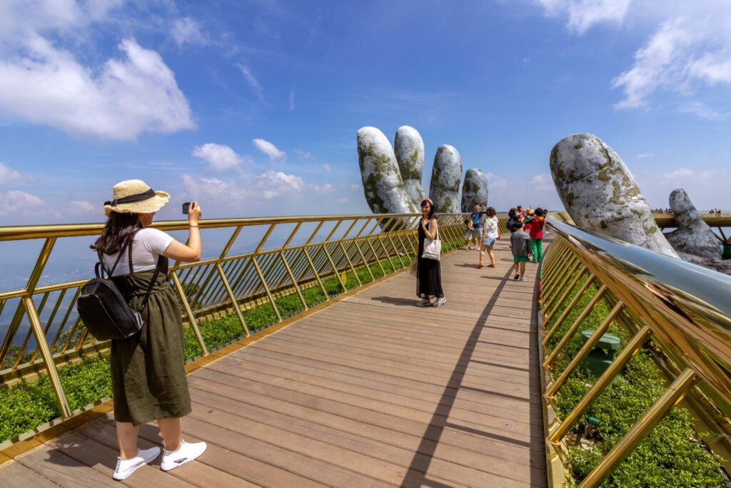 A tourist on the Golden Bridge.