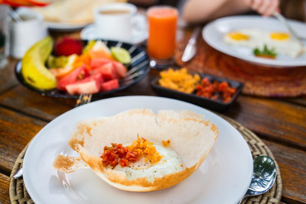 A traditional breakfast of hoppers in Sri Lanka.