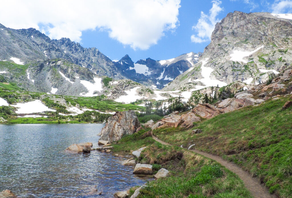 A trail along Lake Isabelle.