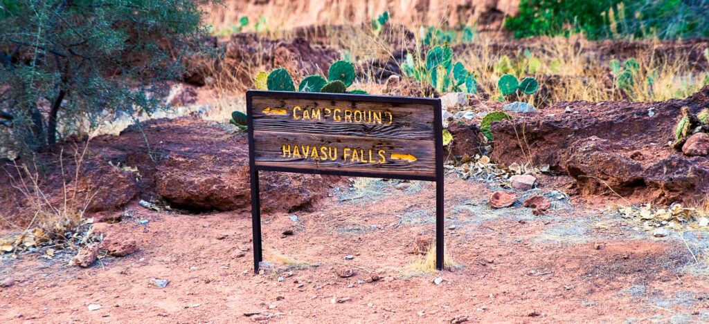 A trail sign for the campgrounds and Havasu Falls