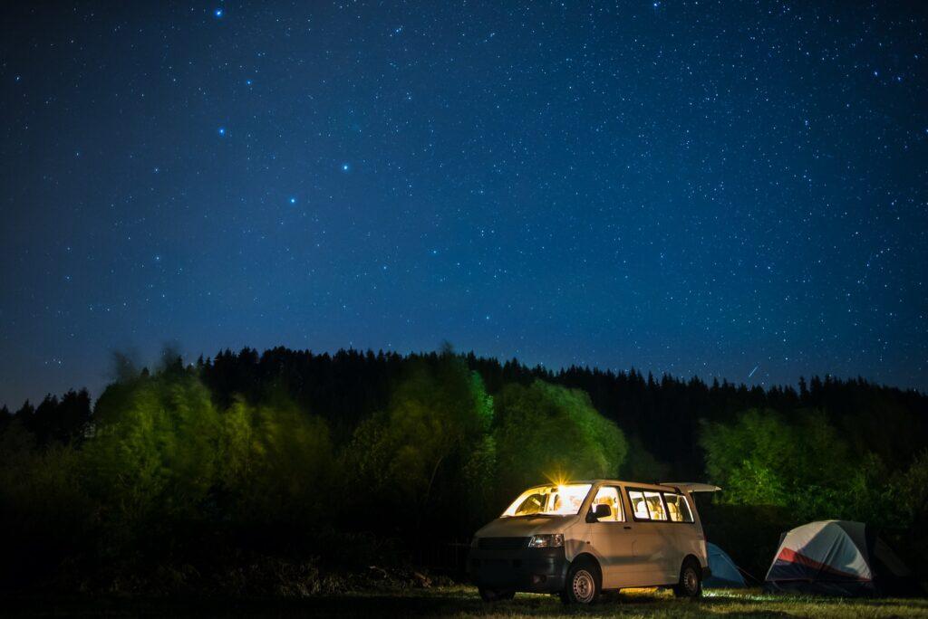 A van under the stars.