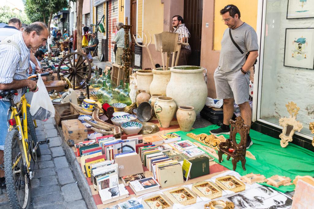 A vendor with Historic Thursday Market wares laid out