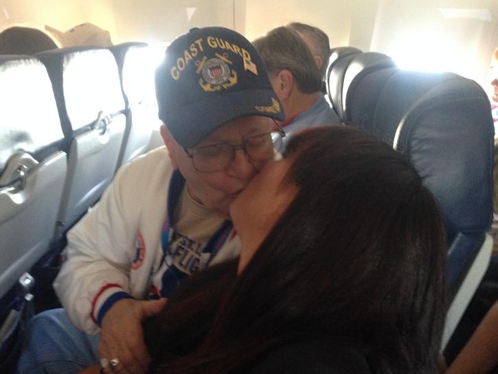 A veteran kisses a flight attendant.