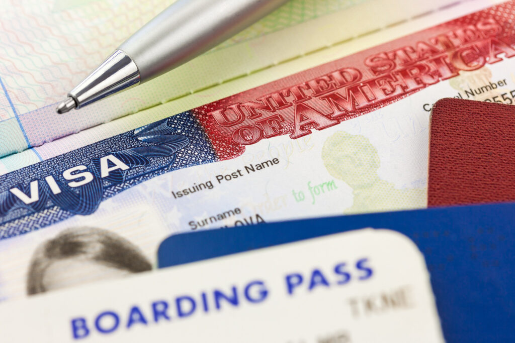 A visa and boarding pass.