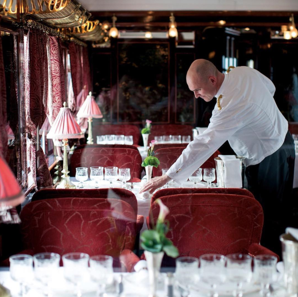 A waiter preparing the Orient Express dinner service.