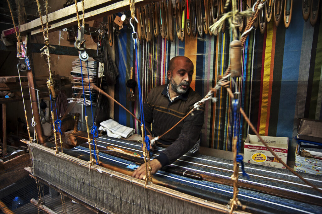 A weaver working on scarves in the medina of Fes.