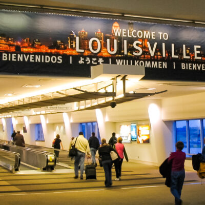"A ""welcome to Louisville"" sign in the airport."