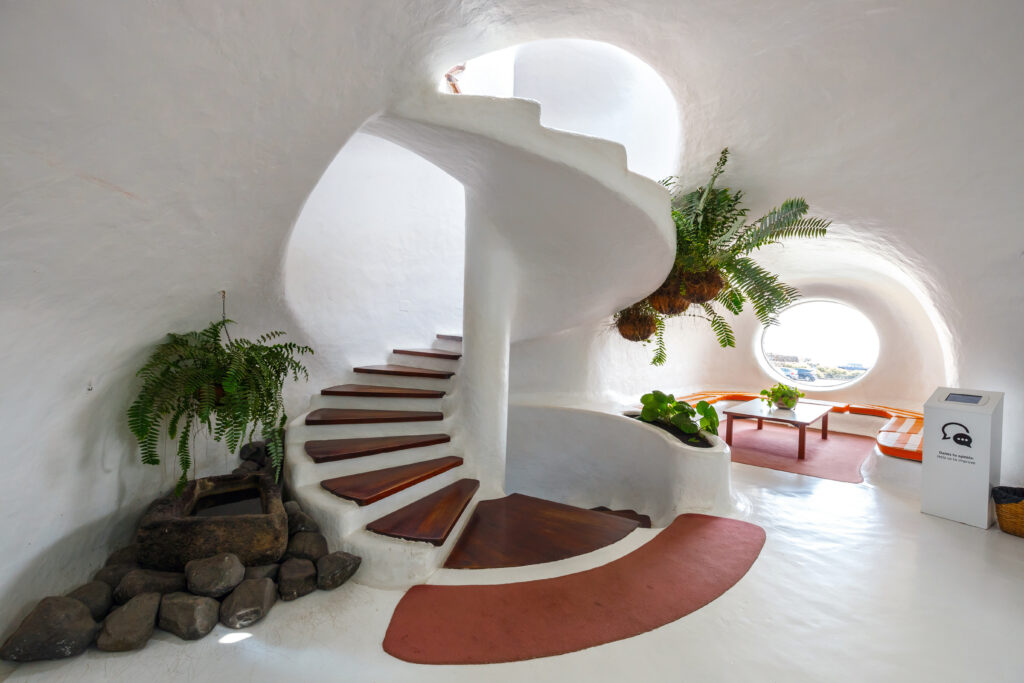 A whitewashed Lanzarote interior with spiral staircase designed by Cesar Manrique