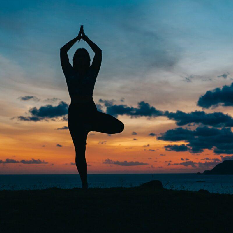 A woman doing yoga at a wellness retreat.